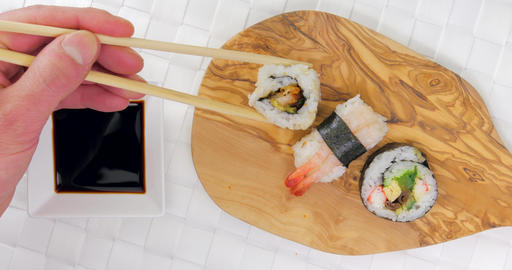 Pick and dip chicken sushi in soy sauce Footage