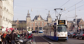 Amsterdam Trams And People Leaving Central Station stock footage
