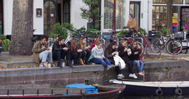 Young People Feeding Birds Canal Amsterdam stock footage