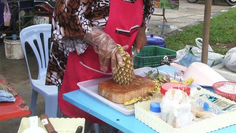 Woman Cutting Pineapple stock footage