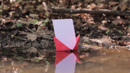 Red paper boat floating on water 102 Footage