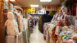 Vivid fabrics at Youngle Market, short move in passageway Footage