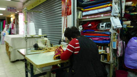 Fabric market work desk, old seamstress work bend over table. parallax shot Footage