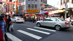 POV crowded pedestrian crossing, traffic, rushing forward with people mass Footage
