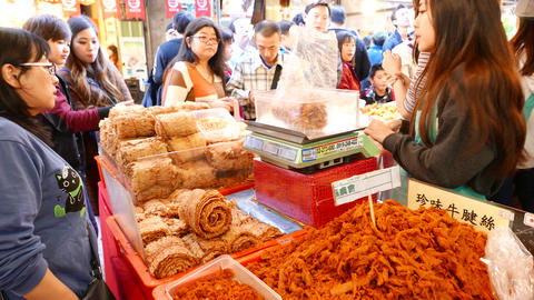 Market stall with dry products, seller girl choosing dried roll for the woman Footage