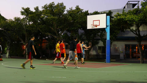 Boys Play Basketball Game At Half Field, One Basket, Public Playground Area stock footage
