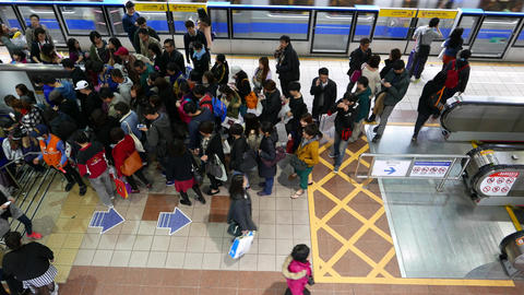 People crowd at staircase entrance, many passengers go down at metro station Footage