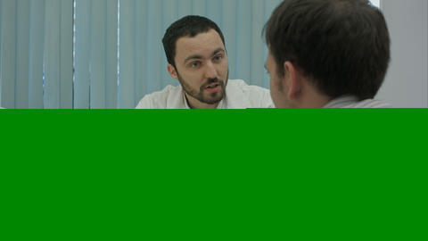 Male Bearded Doctor In Clinic Offer Medicine To Client stock footage