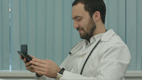 Bearded doctor with a calculator. make calculations of price and satisfied of it Footage