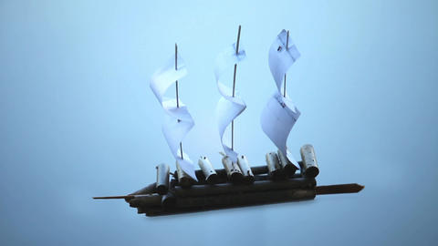 Paper Sailing Ship On A Blue Background stock footage