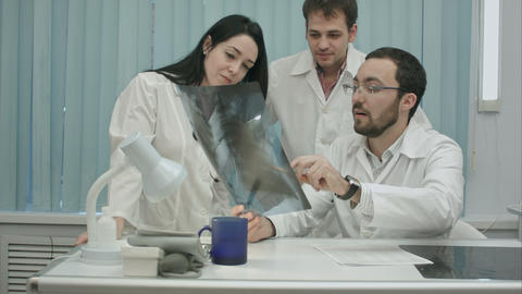 Portrait of young group of doctors looking at x-ray Footage