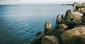 Time lapse of an old breakwater or pier Footage