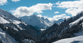 Time lapse of clouds over an alpine valley in Warth, Austria Footage