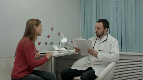Beautiful medical representative presenting new product to doctor Footage