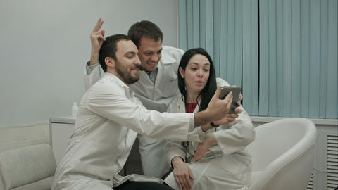 Team of doctors taking selfie all together in a medical office Footage