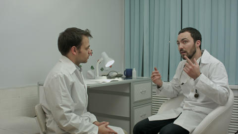 Physician tells to young intern about their medical center Footage