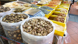Bags with dry mushrooms. Dried foods shop showcase stall Footage