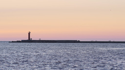 People hanging out at the tip of a breakwater Footage