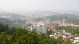 City district aerial view, mountain side, forest on foreground Footage