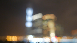 Abstract blurred cityscape in night, half-focused but still blurred Footage