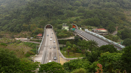 Ultramodern highway tunnels come out mountainside Footage