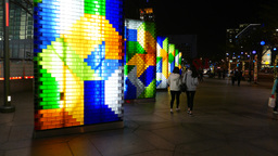 Illuminating colorful installations on the street, brightly glow in the night Footage
