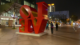 Red LOVE characters on night street of Taipei, backside, parallax shot Footage