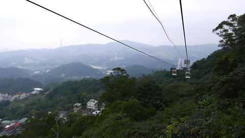 Aerial view from gondola lift slide down, evening time, mountains Footage