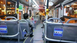 Public bus on night street, interior and 'stop' buttons on handrails Footage