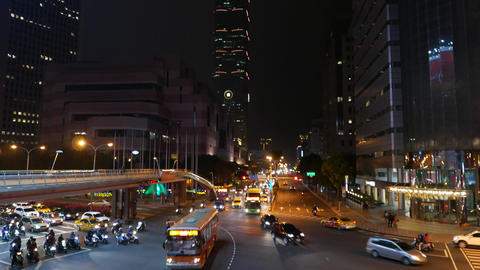 Tilt up from road intersection to night Taipei 101, night view Live Action