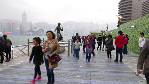 Tourists take picture against Bruce Lee statue, Avenue Of The Stars, Hong Kong Footage