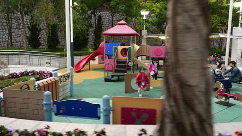 Children playground in park, parallax shot, move around, evening time Footage