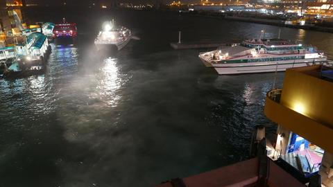Catamaran Ferry Manoeuvre At Night Near Wharf, Time Lapse stock footage