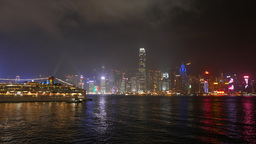 Night view HongKong island skyline, Cruise ship lights on foreground Footage