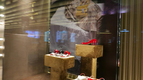 Quick look inside luxury boutique shop-window with red woman's shoes Footage