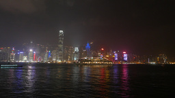 Night city from the harbour, illuminated skyscrapers windows at dark Footage
