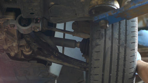 Auto mechanic working on a wheel from the machine damage 44 Footage