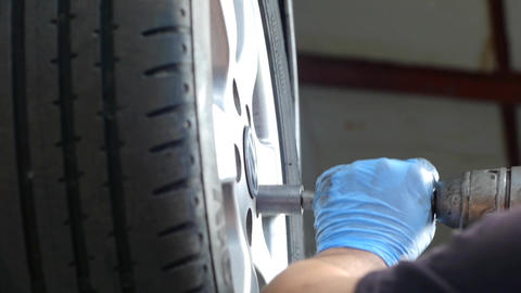 Auto mechanic working on a wheel from the machine damage 46 Footage
