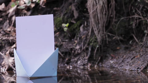 Blue paper boat floating on water 99 Footage
