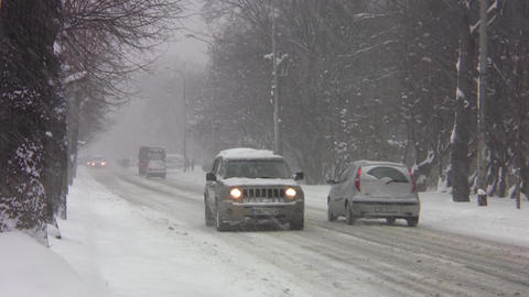 Cars that circulate in winter conditions on a road with snow 74 Footage