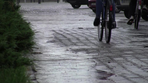 Cyclists rushing home through heavy rain 31 Footage