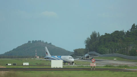 Airplanes taxiing in Phuket airport Footage