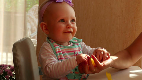 The Baby With Petals Of Yellow Rose stock footage