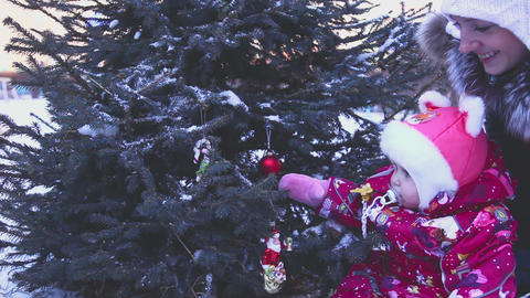 Child playing under the Christmas tree Footage