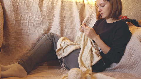 Woman knits a sweater Footage
