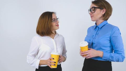 Businesswomen on coffee break telling stories Footage
