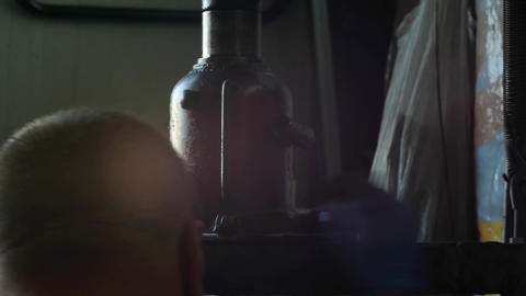 Workers working on a manual press 12 Footage