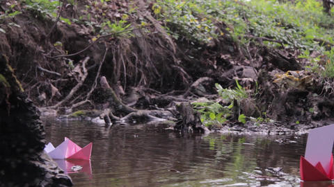 Midges and paper boats on a river in the forest 17 Footage