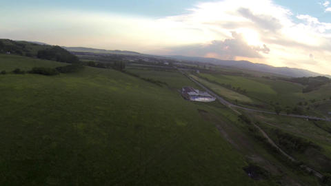Flight over some uncultivated land and cultivated 136a Footage
