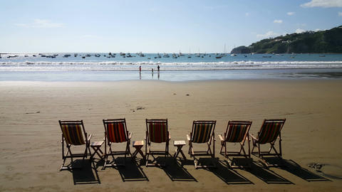 Beach Chairs In A Row On The Beach stock footage